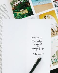 """quote written on paper """"dear me, the only thing constant is change"""""""