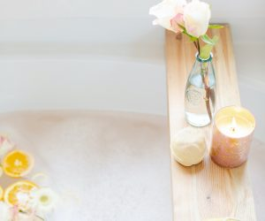 Bubble bath with flower vases and candles